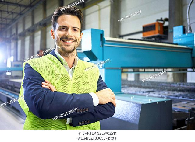 Portrait of smiling manager in factory