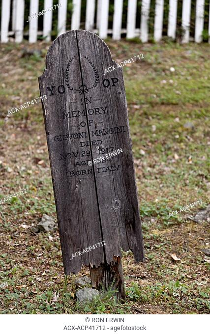 Wooden Grave Marker in the Yukon Order of Pioneers 8th Avenue Cemetery, Dawson City, Yukon, Canada
