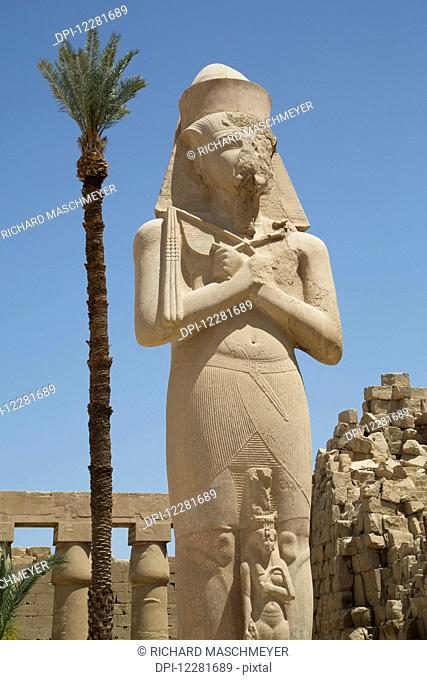 Statue of Ramses II with his daughter Benta-Anta, Forecourt, Karnak Temple Complex; Luxor, Egypt