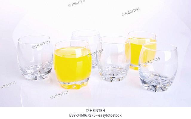 Orange juice in glasses on the background