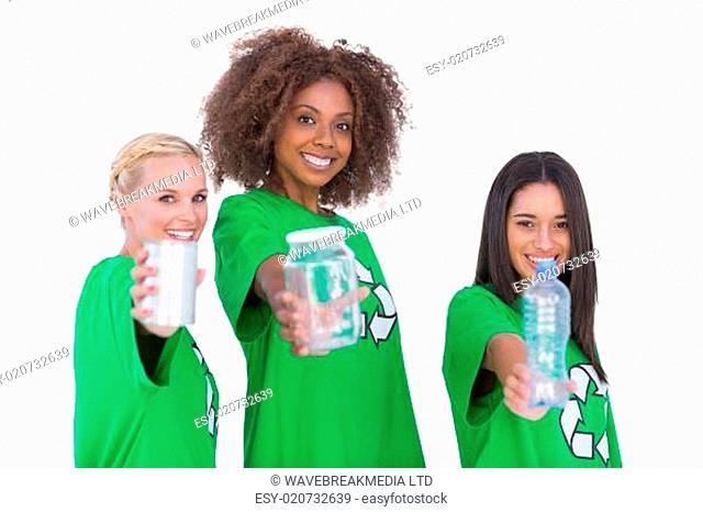Three smiling enviromental showing recyclable matierials on white background