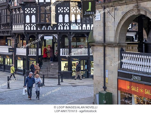 People shopping around the medieval Rows on Bridge Street in Chester