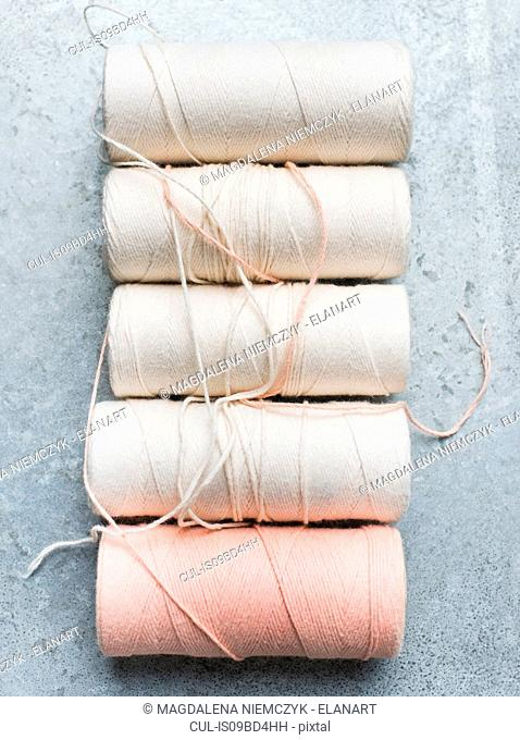 Still life with row of yarn spools, overhead view