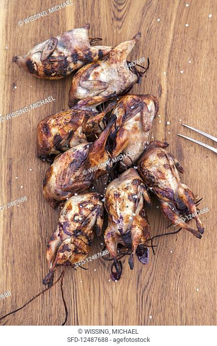 Grilled quails in bourbon berry brine