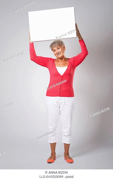 Smiling woman with empty whiteboard. Debica, Poland
