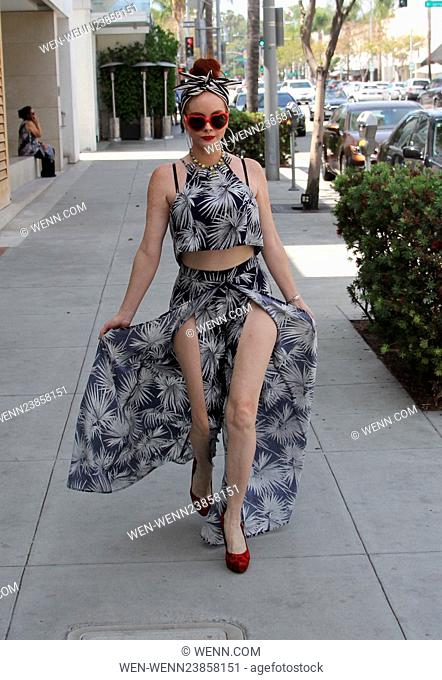 Phoebe Price has lunch at Mulberry Street Pizzeria in Beverly Hills, wearing a slit-to-there maxi dress Featuring: Phoebe Price Where: Los Angeles, California