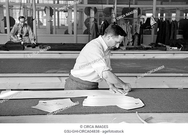 Luis Gushen, Chief Cutter in Cooperative Garment Factory at Jersey Homesteads, Marking out Pattern of Woman's Coat, which will be made in the Factory