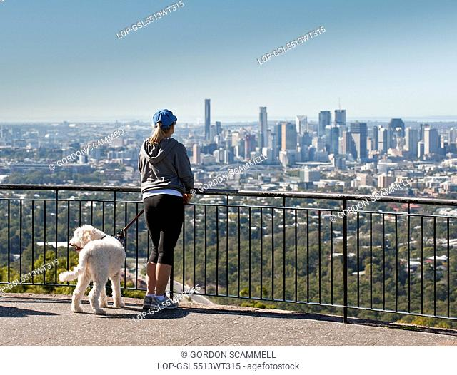 Australia, Queensland, Brisbane. A girl and her dog on the summit of Mt Coot-Tha