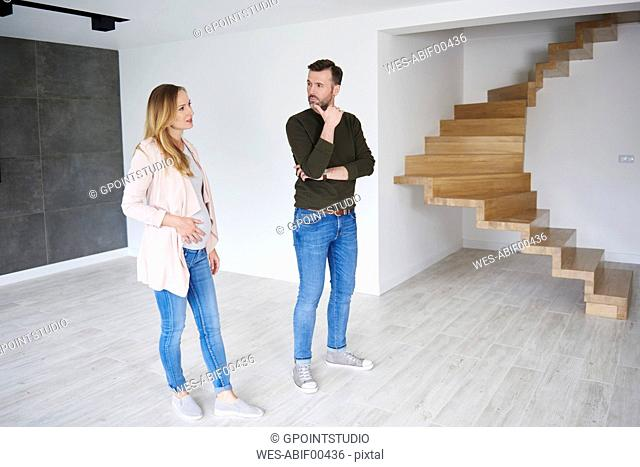 Couple standing in empty flat