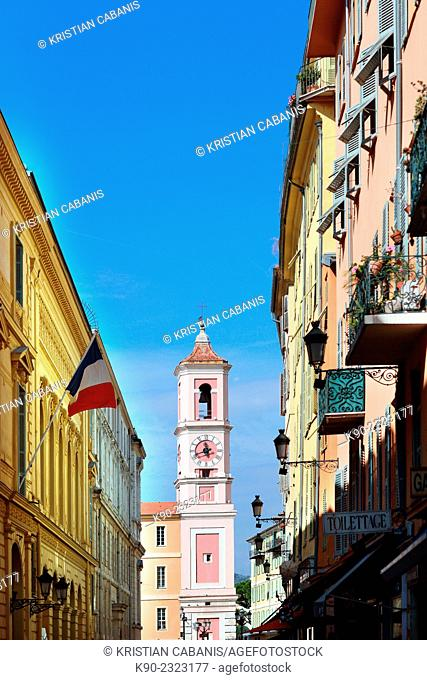 Narrow street with neoclassical buildings and a church at the end, Nice, France, Europe