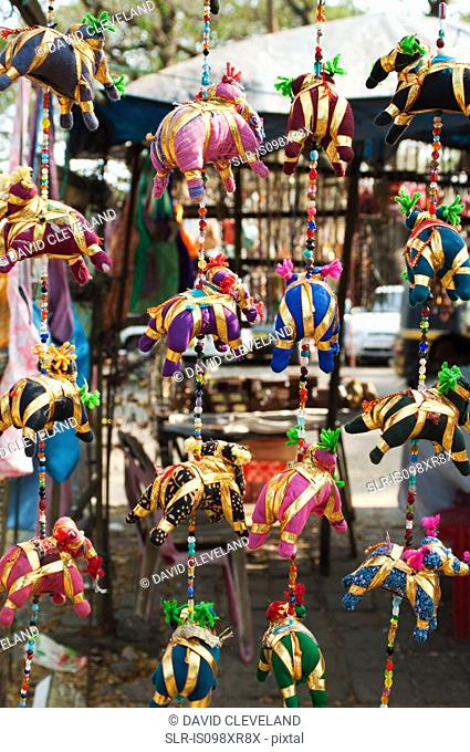 Colourful silk elephant mobiles for sale in market stall, Cochin, Kerala