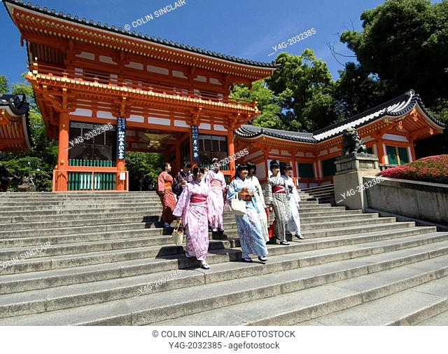 Yasaka Shrine, Maruyama Park, Near Gion, Kyoto, Japan, Schoolgirls in kimonos descending steps of main gateway into Shrine. All very happy