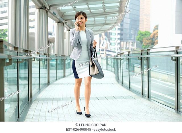 Businesswoman talking to mobile phone