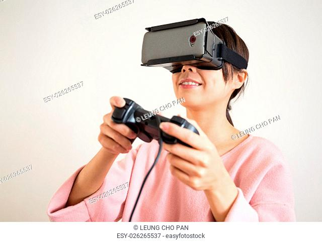 Young Woman play video game with virtual reality