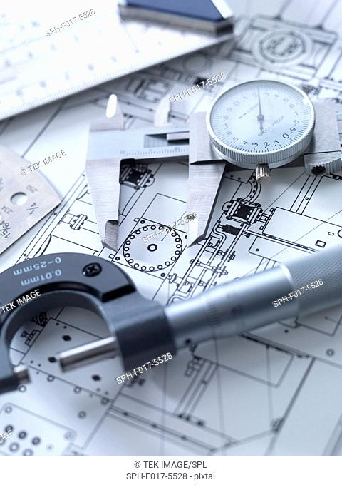 Drawing and measuring equipment on an engineering blue print