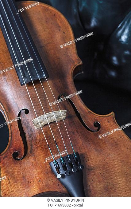 High angle close-up of violin on table