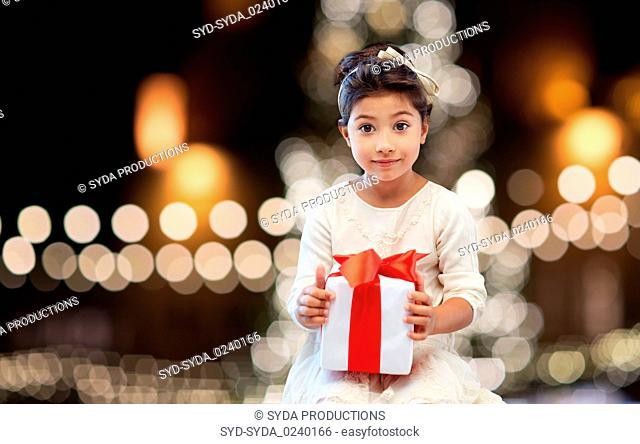 happy girl with gift box over christmas lights