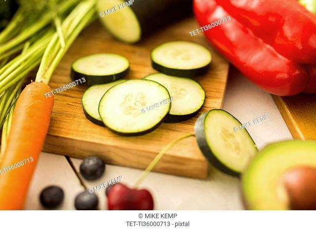 Close-up of zucchini slices on cutting board