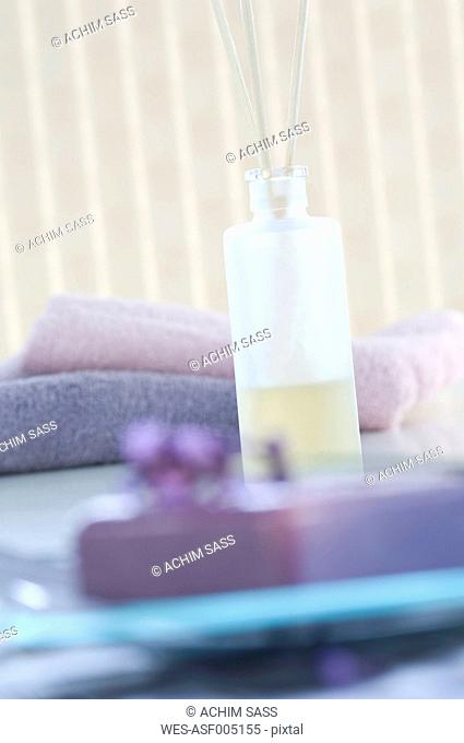 Aroma diffusor, piece of lavender soap and towels