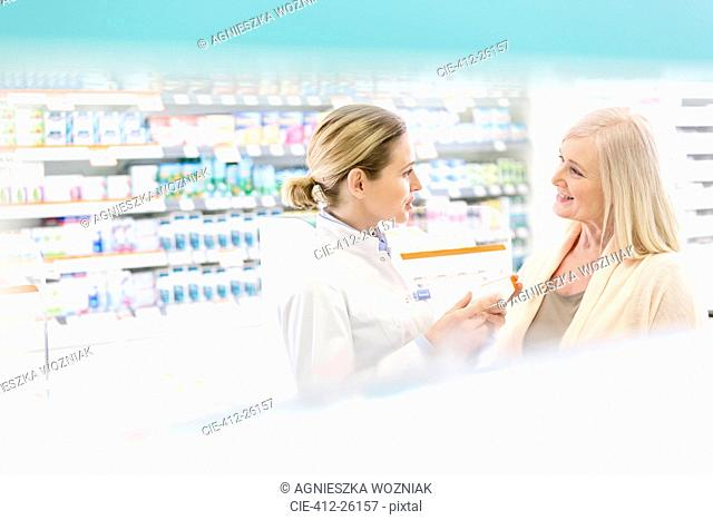 Pharmacist and customer talking in pharmacy