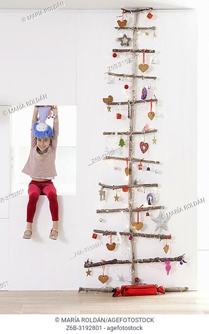 Modern Christmas tree and little girl