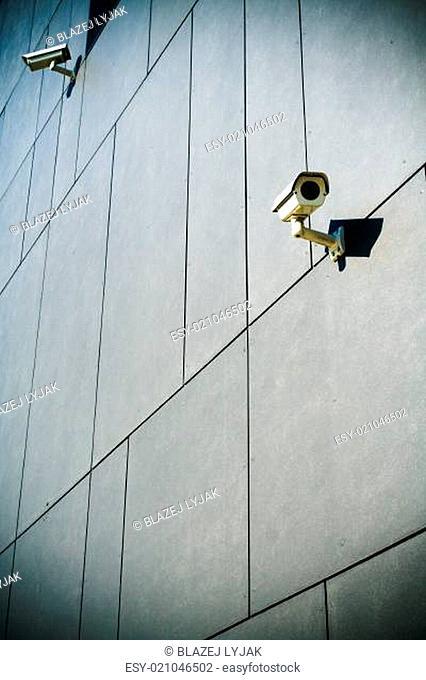 Security cameras on dark building