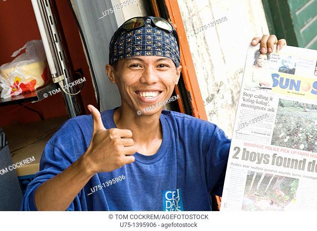newspaper vendor, cebu city, philippines