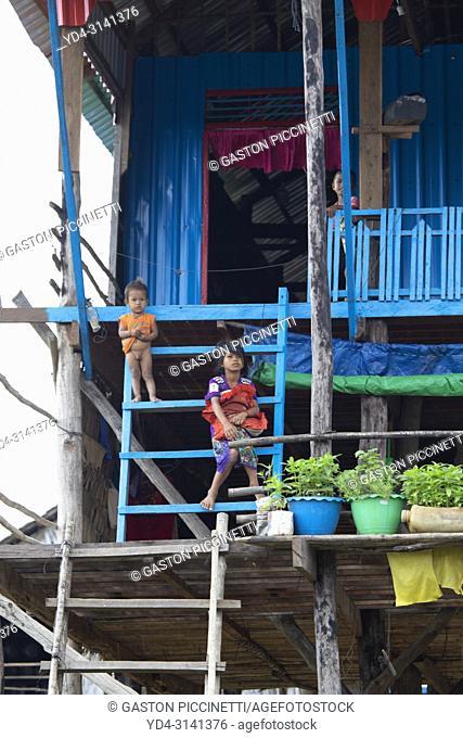Children at the door of their house, floating village of Kompong Phluk, Siem reap Province, Kingdon of Cambodia. Kompong Phluk