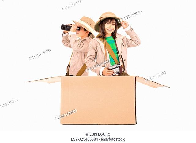 Children's couple in a cardboard box playing safari