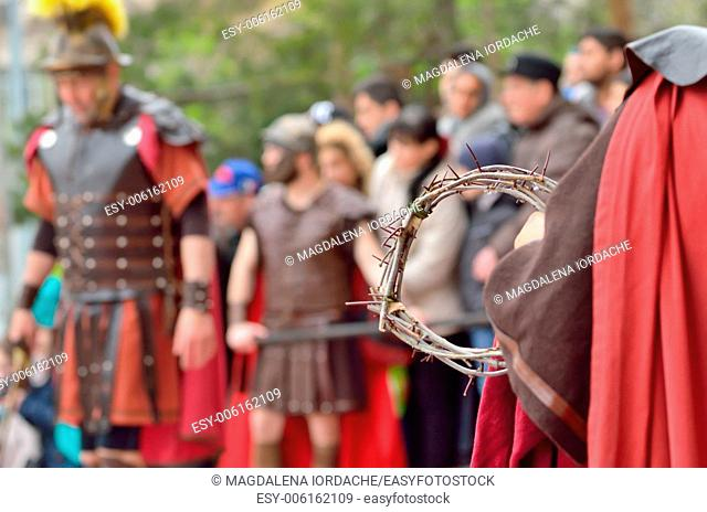 crown of thorns in the hands of a roman soldier