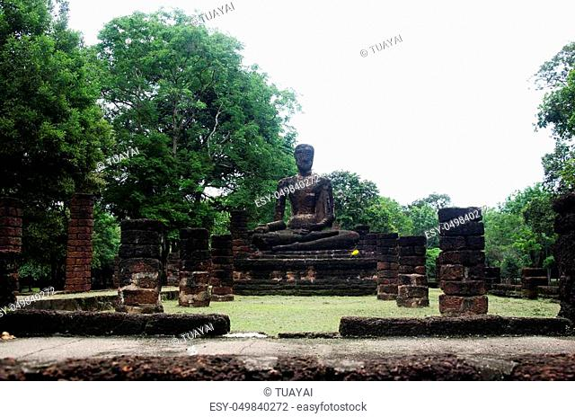 View landscape of buddha statue at Wat Phra Sing in ancient building and ruins city of Kamphaeng Phet Historical Park is an archaeological site and Aranyik Area...