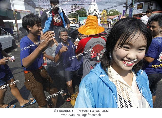 Songkran in Phimai, city streets are filled with people and cars with lots of people having fun with the Thai New Year celebrations
