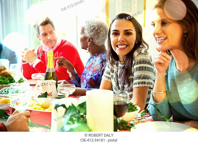 Portrait smiling woman enjoying Christmas dinner at table