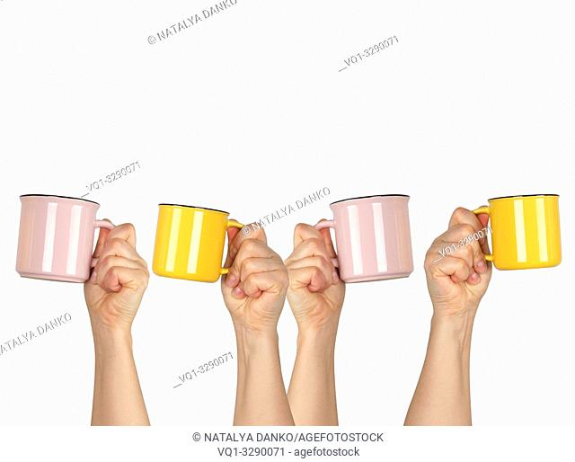 many raised hands up with ceramic cups on a white background, recruitment concept