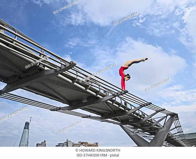 Dancer posing on urban walkway