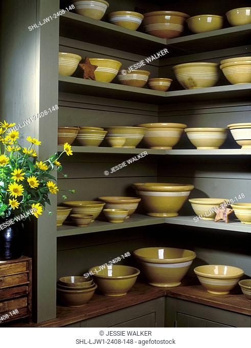 COLLECTIBLES - YELLOWWARE: Corner cupboard display slip-banded yellowware bowls