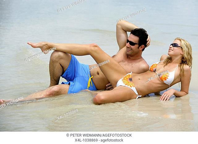 couple relax on tropical beach in Thailand