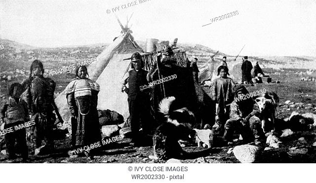 This 1915 photograph shows a group of Esquimos/Eskomos in North Greenland