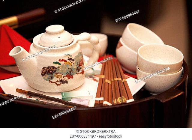 CHELYABINSK ± NOVEMBER 17: Teapot, cups, cigarettes and chopsticks on tray at sushi preparing master class, November 17, 2009 in Holiday Inn...