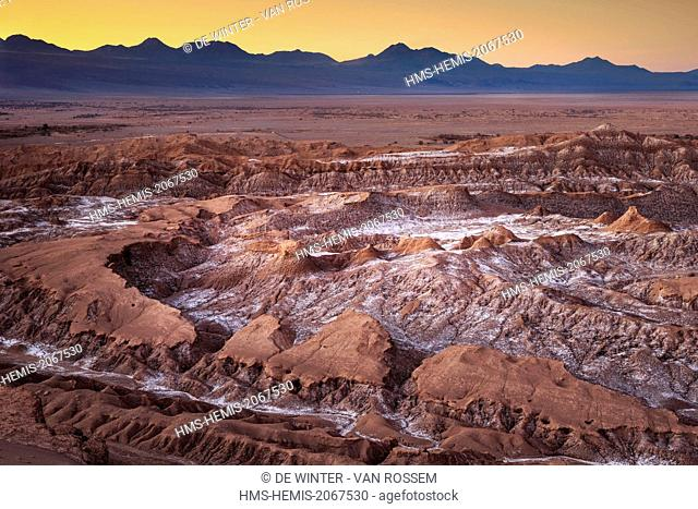 Chile, Antofagasta Region, San Pedro de Atacama, Valle de la Luna (Valley of the Moon), Early morning first sunrays touch upon the barren rocks and salt of the...