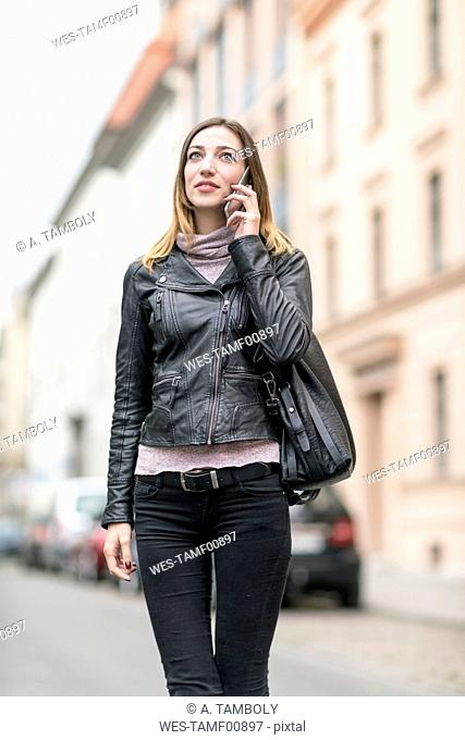 Young woman in the street using smart phone