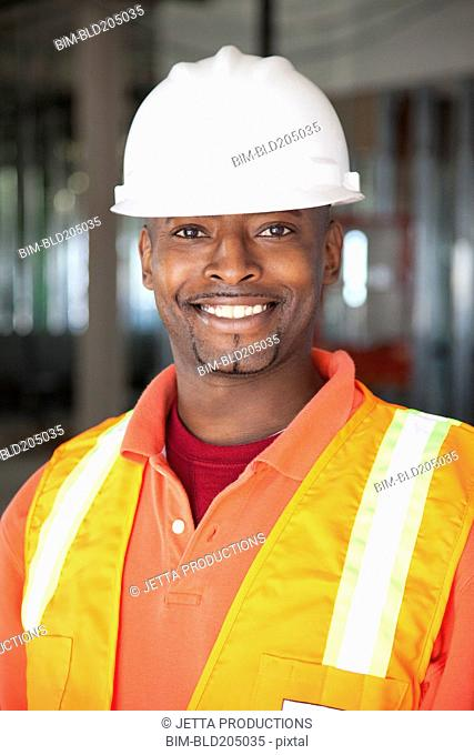African American construction worker smiling