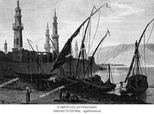 Wood engraving depicting shore with boats, people walking along the shore, minarets in the background, captioned 'Girgeh, from the mooring place on the south'