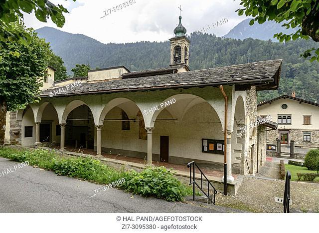 view of Renaissance arcade at Giacomo and Vincenzo saints Romanesque church , shot in bright summer light at Gromo, Bergamo, Lombardy, Italy