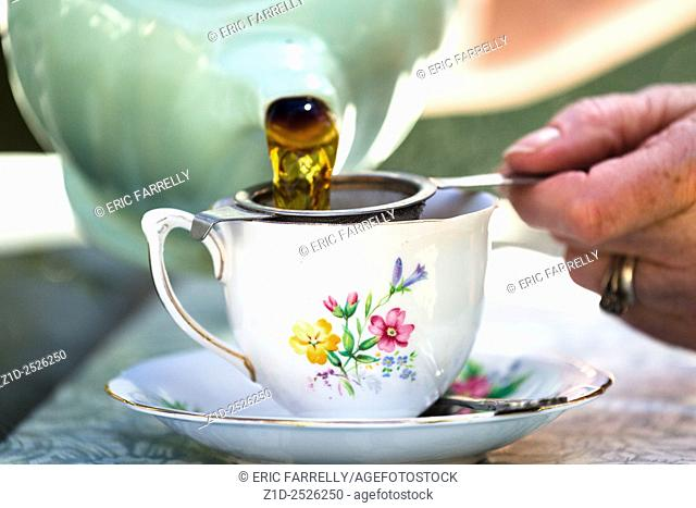 Pouring tea at Ludham village tearoom. Norfolk broads England UK