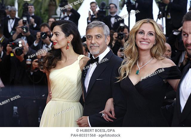 Actress Julia Roberts (r), actor George Clooney and his wife Amal Clooney attend the premiere of Money Monster during the 69th Annual Cannes Film Festival at...