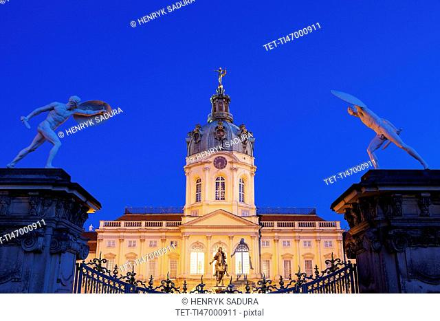 Charlottenburg Palace facade and entrance statues at night
