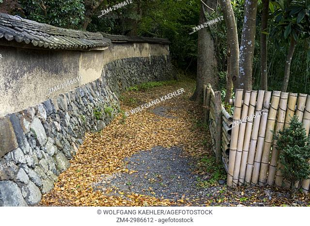 A stone wall is surrounding the garden at Heki-tei, a 300 year old former samurai house in Kyoto, Japan