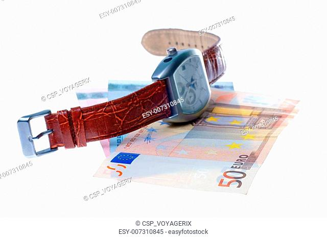 wristwatch and euro money
