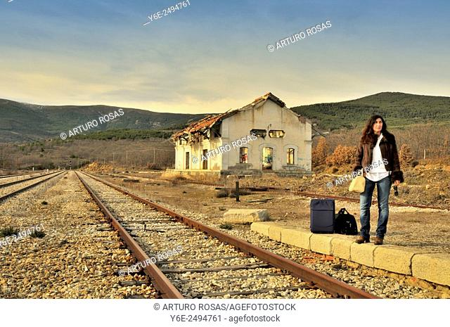 Woman in railway station. Buitrago de Lozoya, Madrid province, Spain